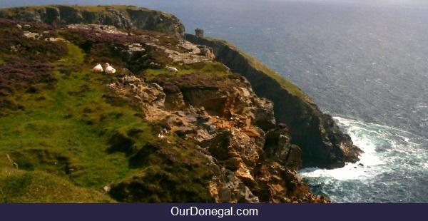 Historic Watchtower Dwarfed By Slieve League Cliffs