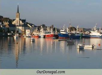 Fishing Boats And St. Mary's Church Reflected In Killybegs Harbour, Donegal, Ireland